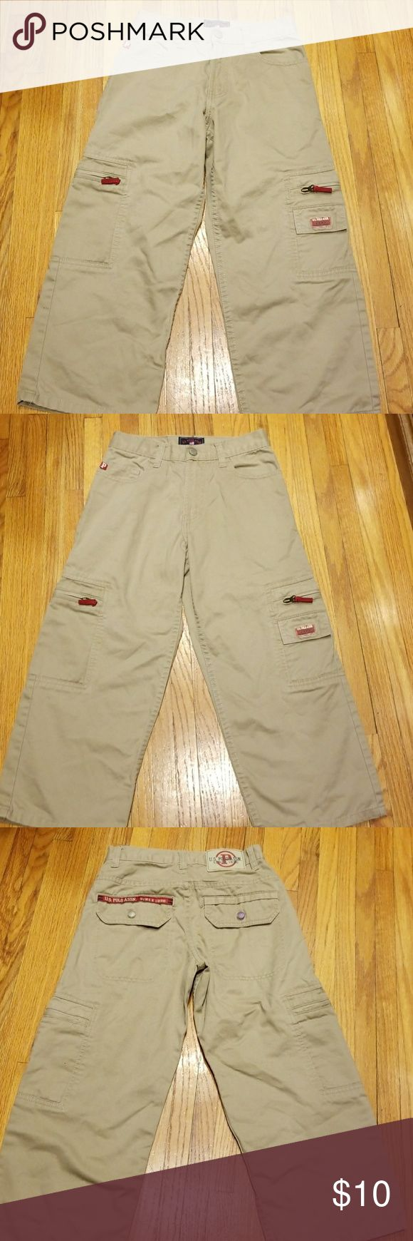 US Polo Assn khaki cargo pants 8 U.S. Pol Assn. khaki cargo pants size 8 like new condition!  Back pocket has a snap closure one is clear and one appear slightly bluish, see picture. U.S. Polo Assn. Bottoms Casual