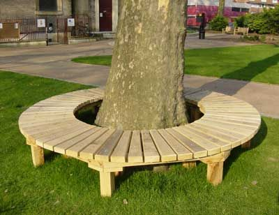 Circular green oak bench by Cookson, McNally and Straker