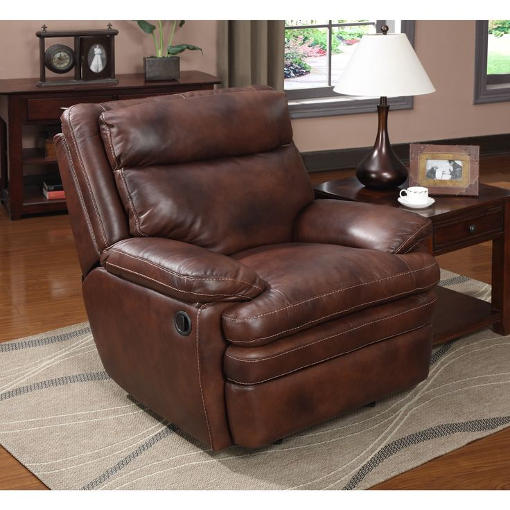 Ample seating, contrast stitching and soft-touch leather combine to create this Clarkston rocker recliner. Plush to sit in and yet fully supportive, the arms are pillowed for additional comfort and is crafted of 100-percent top-grain leather.