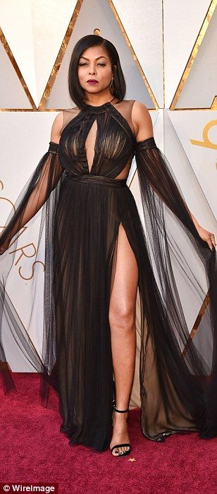 Wow: Taraji P. Henson looked absolutely incredible in her sheer black gown, which featured...