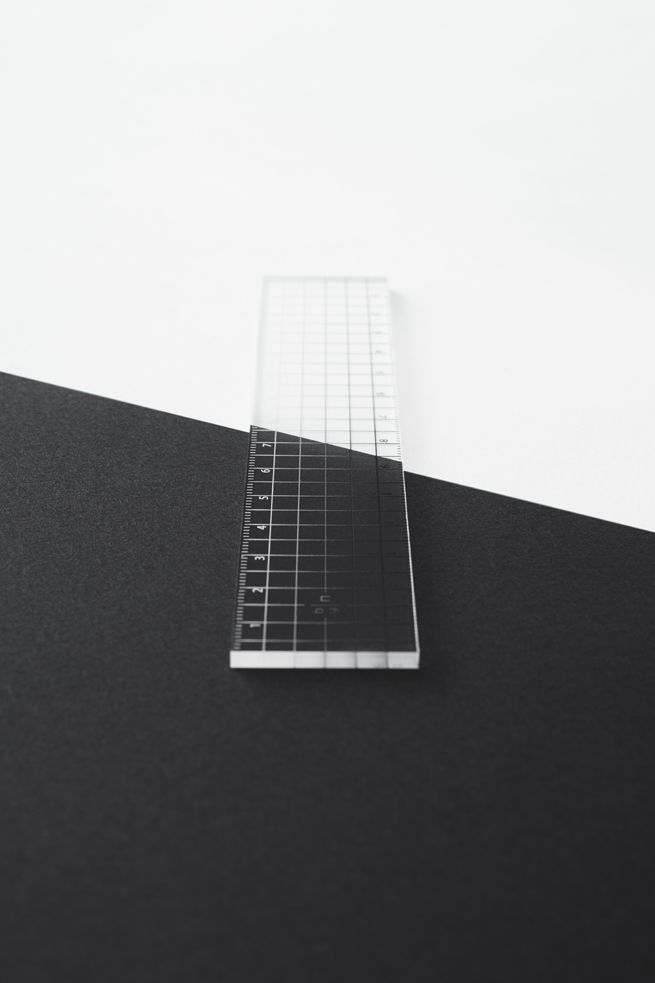A clear acrylic ruler whose marking fade from white to black, making the ruler easy to use on dark and light surfaces alike.