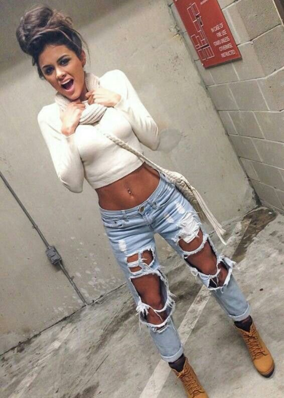 The jeans with this top wit da boots and the hair...just works