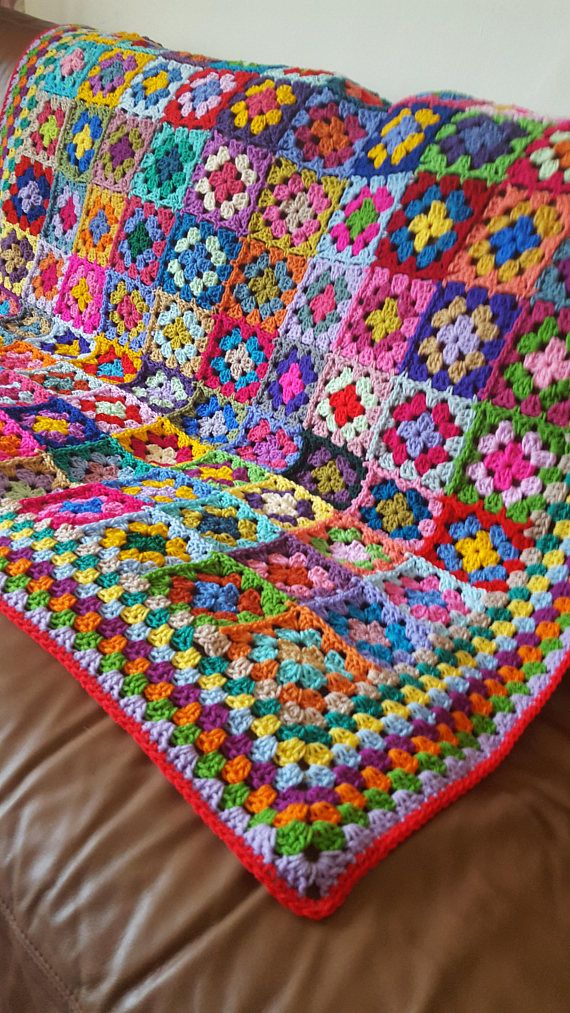 Here is a gorgeous new blanket crocheted using 100 different colored granny squares. This distinctive blanket is bright, cheerful and happy and reminds me of the fun fair. Would make a superb gift and a lovely heirloom quality addition to any household. Measures 50 x 50 approx. Made