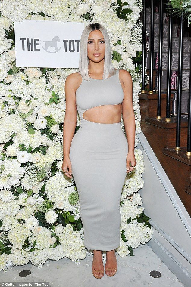 Head turner: Kim Kardashian certainly maintained her striking sense of style on Monday as she slipped into a skintight cutout dress as she arrived at Laduree at The Grove mall for The Tot's event which benefited the Children's Hospital of LA