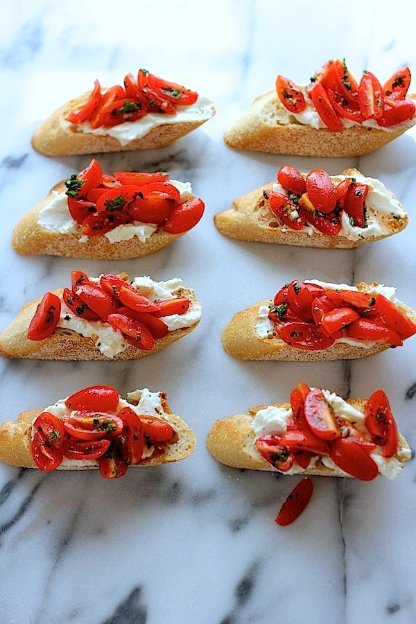 Crostini with whipped feta and tomatoes.
