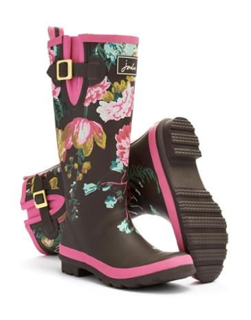 Joules Womens Rain Boot, Brown Floral.                     From striking stripes and detailed florals to scenes that sing of our country heritage. No matter where you are from farmyards to festivals, our new printed rain boots will make sure you stand out from the crowd.