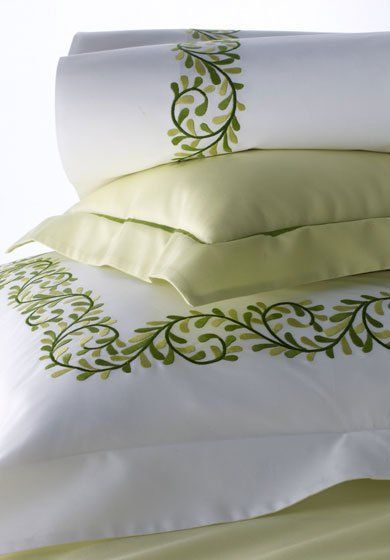 Melissa:  A repeating swirl of vines and leaves embroidered in three colors animate this fresh-looking bed set. Custom-made by Léron in a choice of 150 embroidery colors. www.leron.com