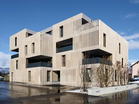 Apartment buildings by Group8 clad in strips of travertine stone