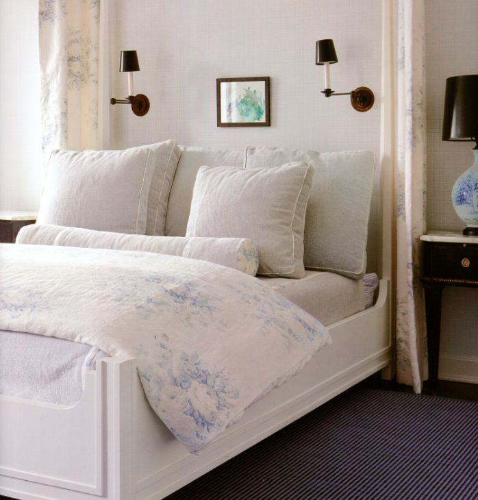 Serene bedroom with linen bedding and linen drapes at bed by Darryl Carter
