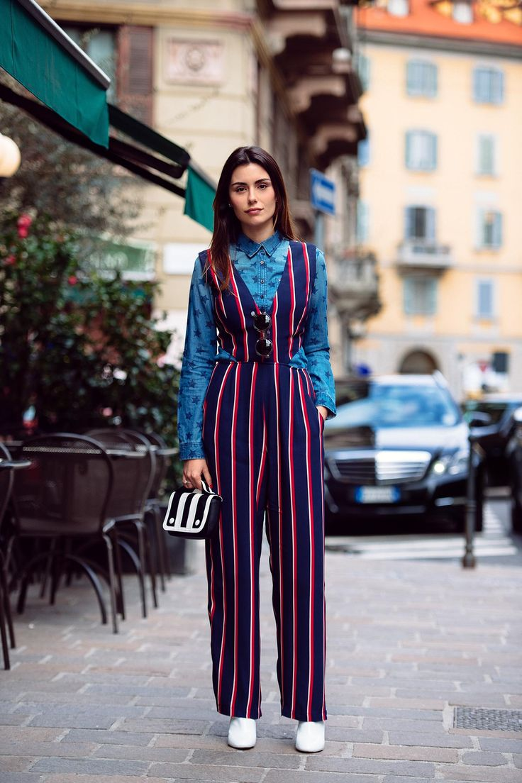 This is a bold look from Milan and we love it. Striped jumper suit with a denim shirt underneath, a clash of colours, fabrics and styles which just works.
