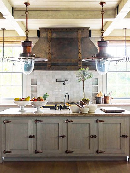 very cool kitchen, especially the pendant lights and the hood