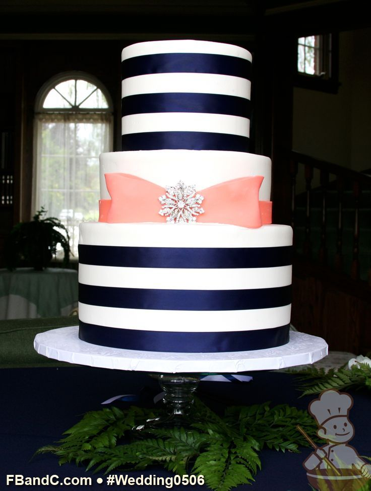 """Design W 0506   Butter Cream Wedding Cake   12""""+9""""+6""""   Serves 100   Navy Blue Satin Ribbons, Coral Fondant Bow, Broach   Custom Quote"""
