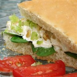 Basic Chicken Salad Recipe  1/2 cup mayonnaise   1 tablespoon lemon juice   1/4 teaspoon ground black pepper   2 cups chopped, cooked chicken meat   1/2 cup blanched slivered almonds  Celery Salt or 1 stalk celery chopped