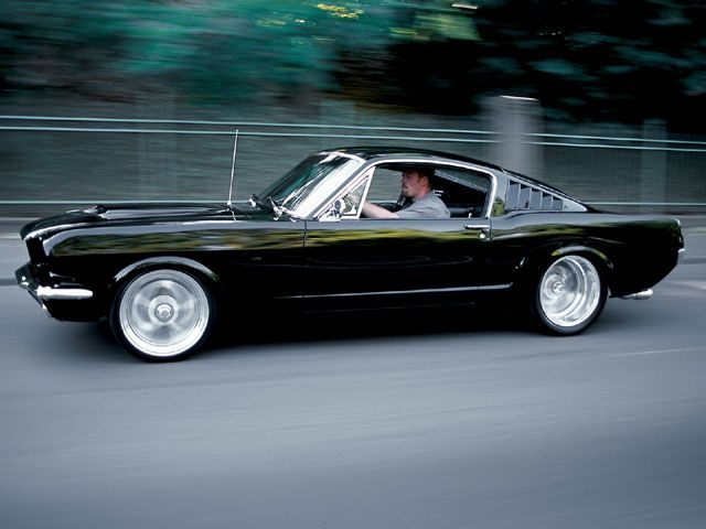 Jason Johnson built this Raven Black '65 Mustang fastback; it's a crossover between restomod and street rod. Inside, it is fairly modest and subtle in its execution.