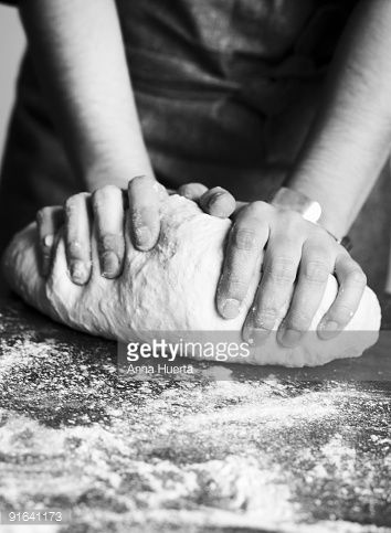 Stock Photo : Person kneading dough, close up, mid section (B&W)