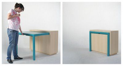 Clever! Pull out table/cabinet. Maybe for a desk or a kitchen to give more working space?    I've never seen a pull out table like this, I love how it has a fully functional cabinet!