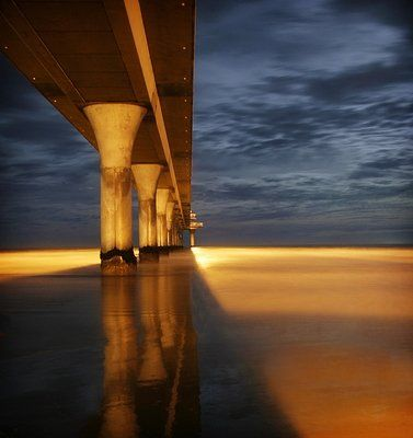 under the pier at dusk