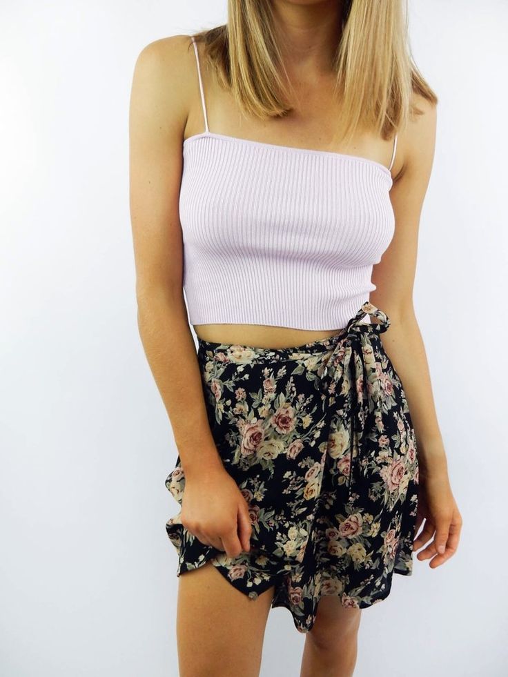 The Vintage Rose Wrap Skirt features a floral print throughout, wrap style, mini length, and tie-up closure.
