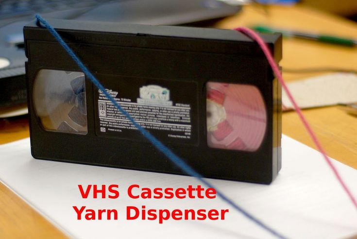vhs tape  don't we all have some still in the house.  yarn dispenser but i think i'm going to try for ribbon
