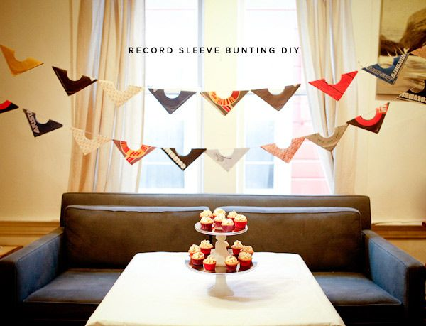 DIY record sleeve bunting= pretty awesome. would be great for a music themed wedding. hmmm.