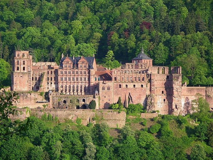 """Heidelberg Castle - This 600-year-old castle lies on the Neckar River, and contains both Gothic and Renaissance styles of architecture and design. The Heidelburg Castle is one of the """"top castles in Germany""""."""