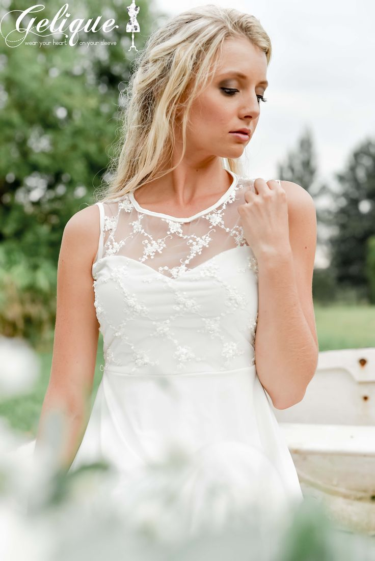The Gelique Daisy dress with a Beaded Tulle bodice that is perfect for a Simplistic but still Elegant Wedding Dress