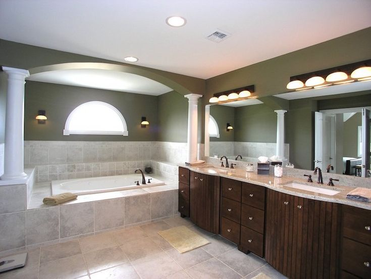 Luxury master bathroom idea with wooden cabinet and arched pillars. 50 Magnificent Luxury Master Bathroom Ideas ➤To see more Luxury Bathroom ideas visit us at www.luxurybathrooms.eu #luxurybathrooms #homedecorideas #bathroomideas @BathroomsLuxury