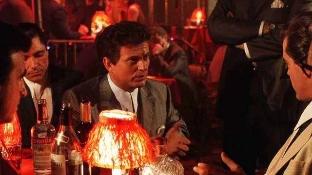 """Tommy DeVito  Joe Pesci , Godfellas DEFINING MOMENT: The shinebox to-do is pretty iconic but the knife-edge tension of DeVito's improvised drinking confrontation with Henry Hill (Ray Liotta) remains unmatchable. """"Funny how? What's funny about it?"""""""