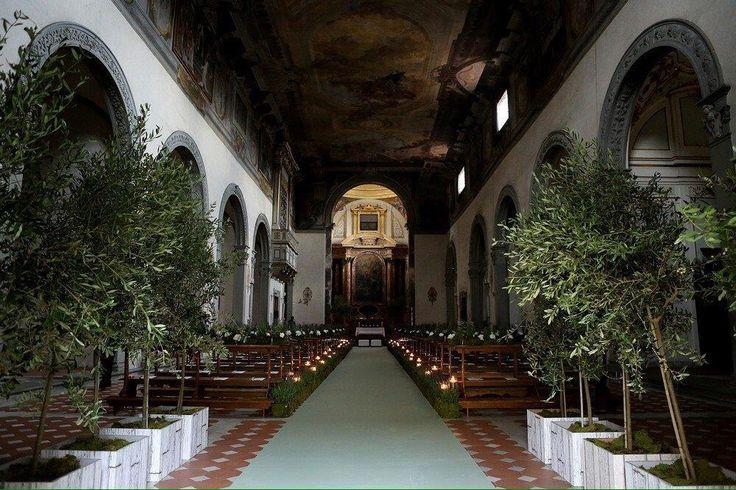 Olive trees and green aisle for wedding celebration