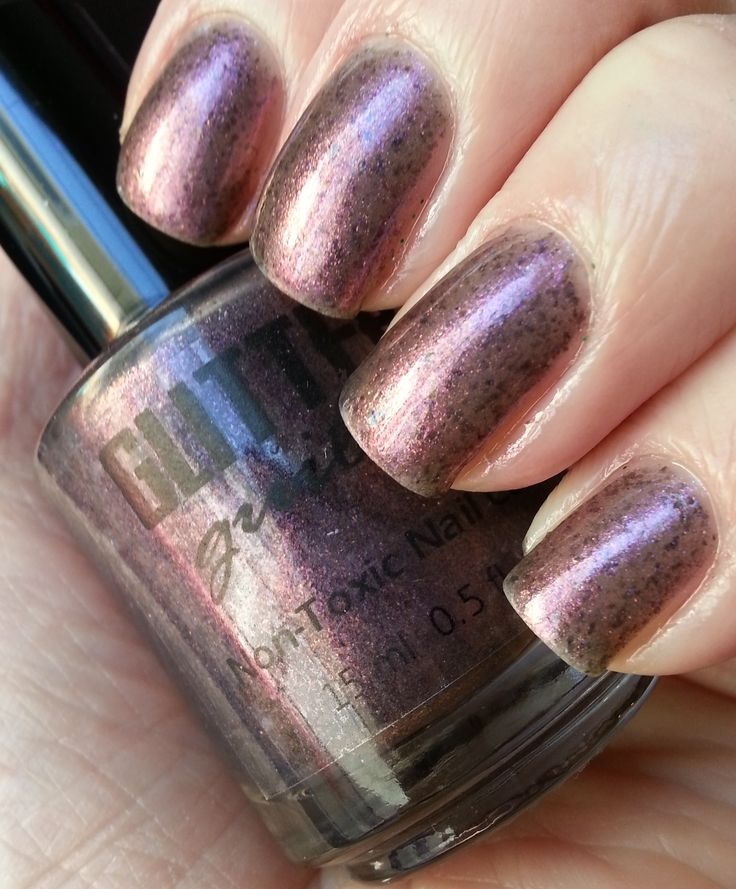 """""""Double Agent"""" has bronzy/taupe micro flakes with deep violet flakes. Shifting from a violet/gray to a bronzy pink. Totally unique and absolutely beautiful!"""