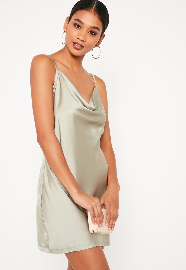 Slip into something silky in this beaut' cami dress featuring a cowl neck and mini length.