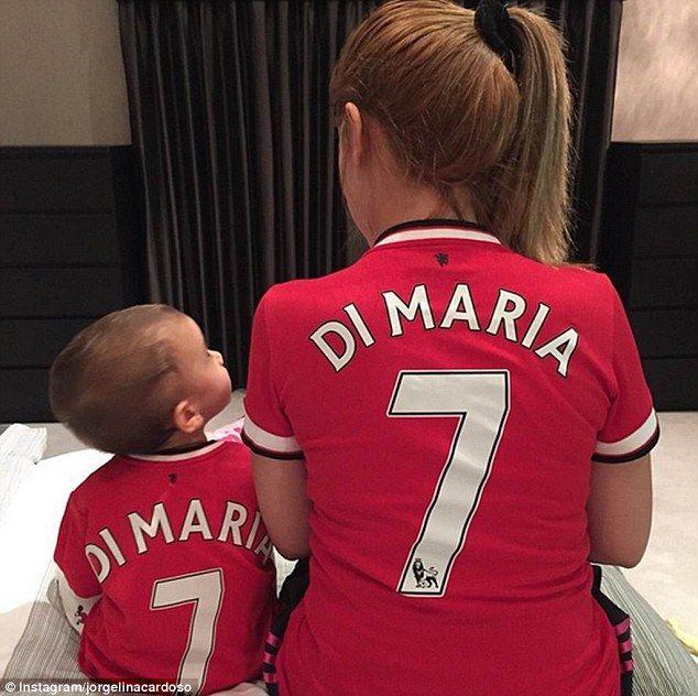 Di Maria's wife Jorgelina Cardoso and his daughter Mia are pictured in Manchester United t...