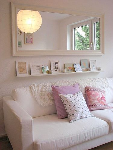 shelf and mirror over couch