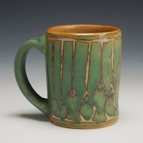 Green/Orange mug. Julie Covington""