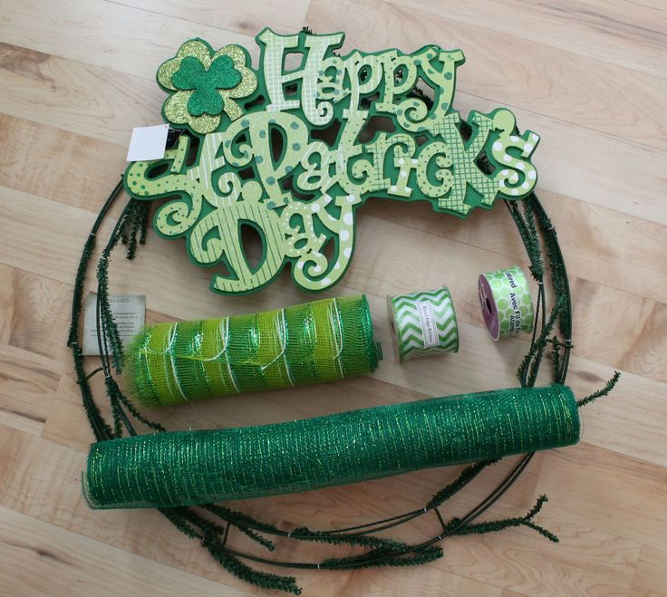 St.  Patrick's Day is a festive and fun Irish tradition that has become a  classic American holiday over the years.  The green color hues provide a  creative opportunity to craft festive wreaths for the celebration.   This mesh ribbon wreath tutorial is really all about happiness!  It was  just as fun to make as it is to look at.  The chevron and Polk-a-dot  ribbon add to the whimsical lettering on the sign.  Follow along to  craft this mesh wreath all by yourself!Giveaway Contest Rules!You…