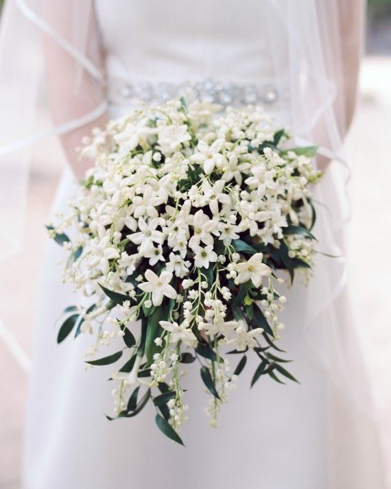 Amaryllis, Inc. created the delicate bouquet of lily of the valley that Taylor carried down the aisle. For the bridesmaids? Small bouquets of garden roses, peonies, and various spring greens.