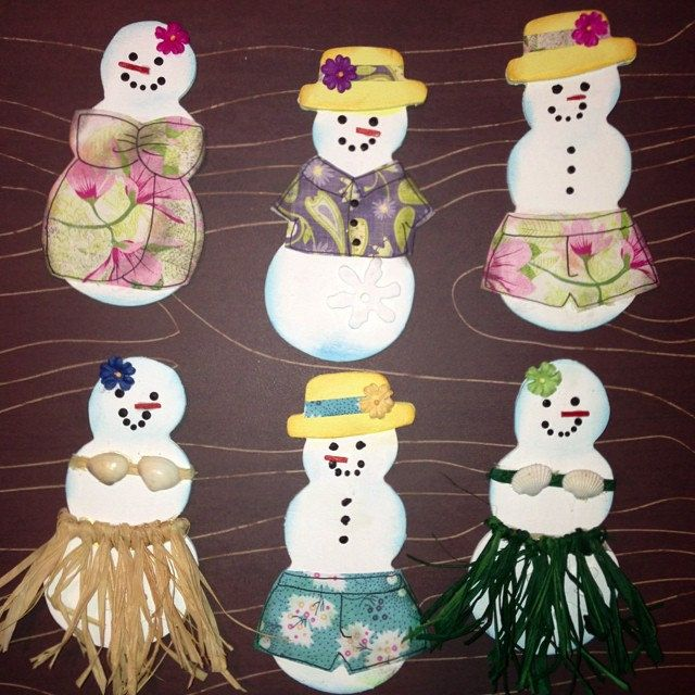 Christmas Luau Snowmen With tropical Hawaiian shirts, shorts and hula skirts... For the Christmas tree.. handmade with unfinished wooden snowmen cut outs, various papers, paints, shells and raffia