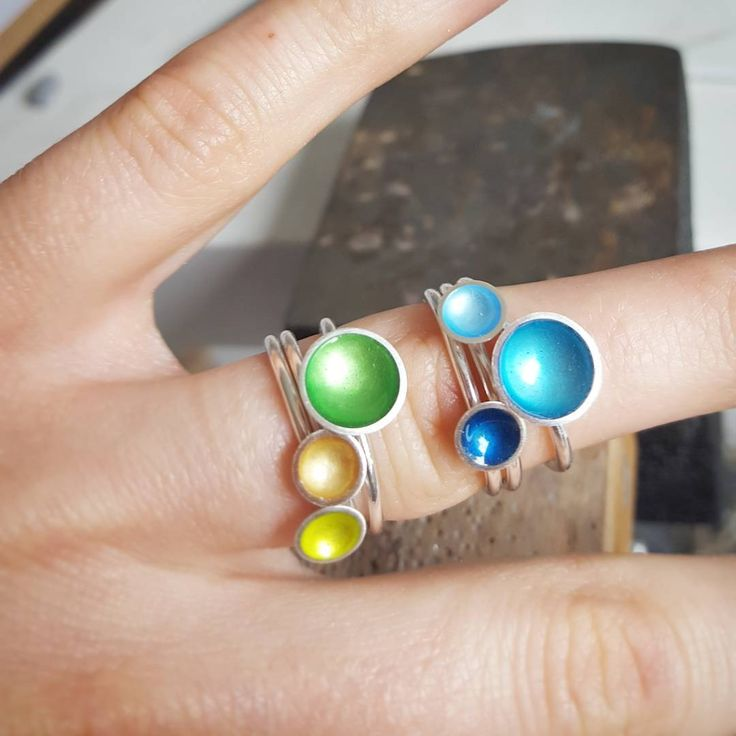 Look at the shiny enamel and silver rings...don't look at the jeweller's hands! #neverbeahandmodel #silverjewellery #contemporaryjewellery #enamel #silver #handmade #Kokkino #colour #instajewels #showmeyourrings