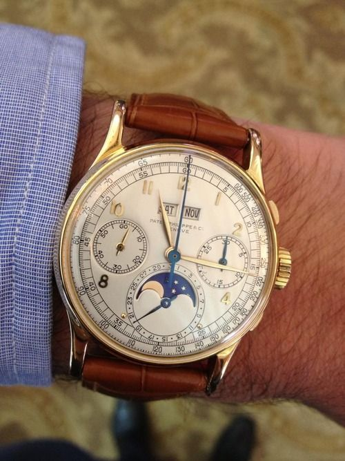 Horlogerie Genevoise. It's so French, I can't even find a link I can understand that tells me the price of this bad boy.