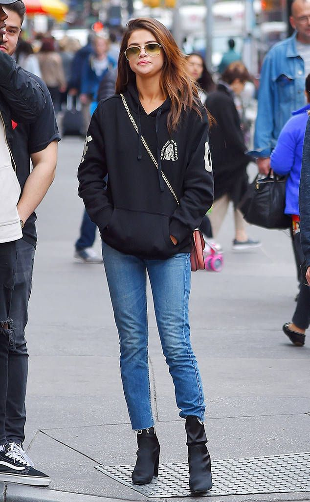 Urban chic! The songstress is spotted wearing a sweatshirt and boots while out and about in Times Square.