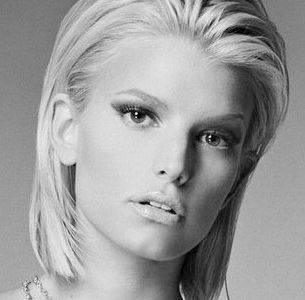 Jessica Simpson black and white headshot with short hair