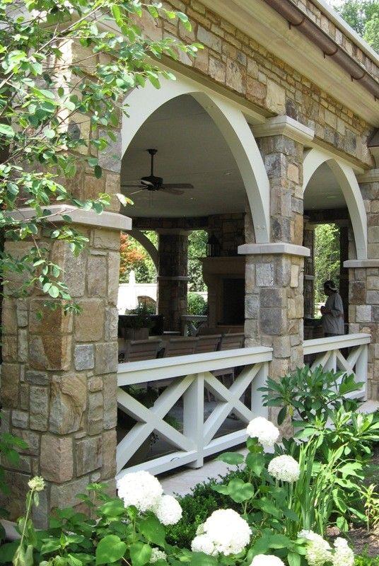 Stone, arch, wood railing