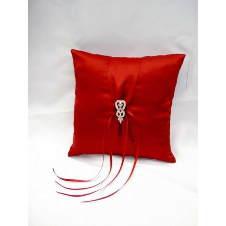 Crimson Red Ring Bearer PillowThis unique ring bearer pillow from One Classic Wedding is sure to make anentrance. The stunning pillow is covered in crimson red silk coversandadorned with an exquisite antique brooch.
