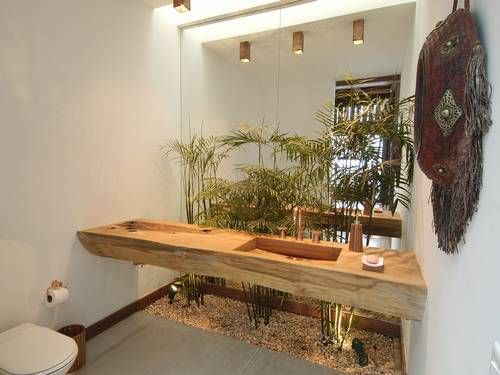 Bathroom in beach house in Angra dos Reis, RJ - Brazil. Salvage wood sink and plants inside bathroom to give an outdoor feeling.