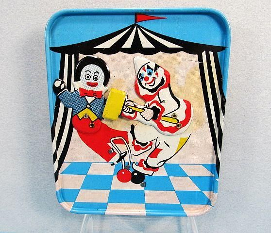 icollect247.com Online Vintage Antiques and Collectables - Golliwog & Clown Tin Clicker Toy 1960s Germany?