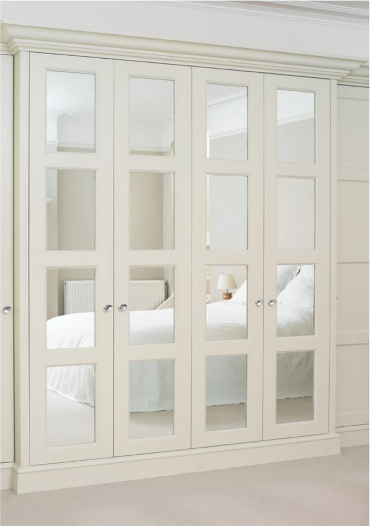 Elegant mirrored doors turn any small closet into something special. What a dream!