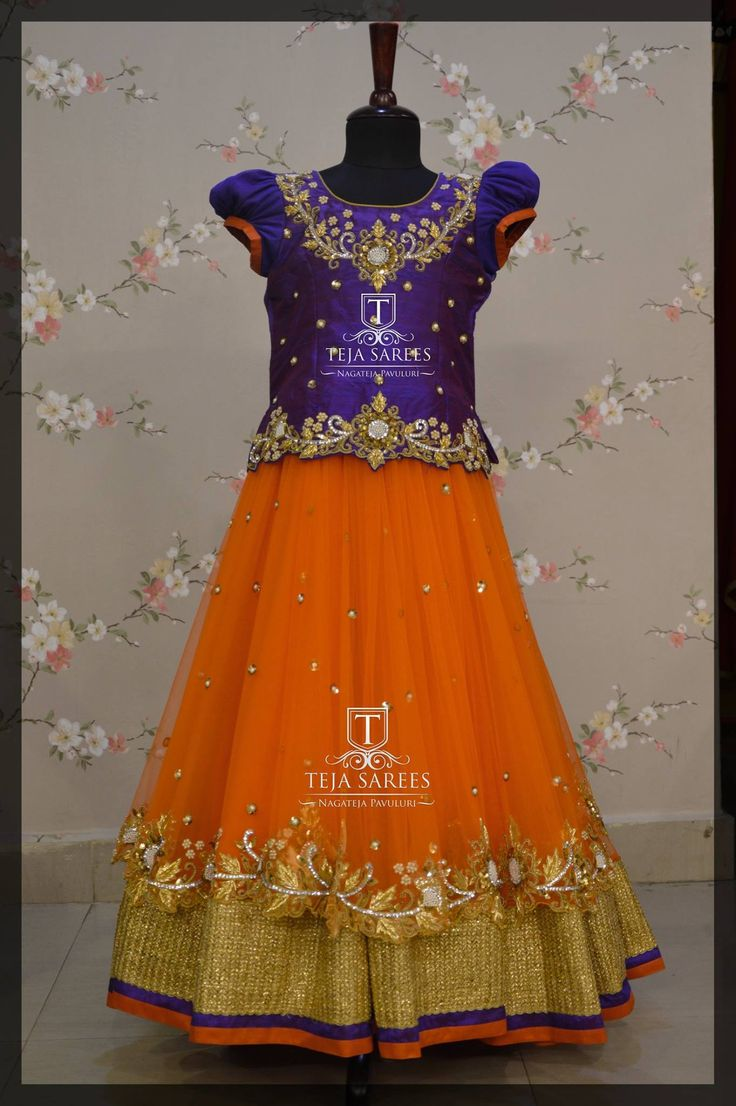 Beautiful orange color lehenga and purple color top from Teja from kids.TS-KDS-188Available For queries/ price details Whats App/call  on8341382382 please mail  attejasarees@yahoo.com. 22 July 2017