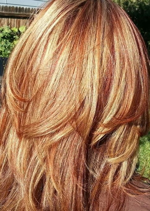 red or auburn hair with subtle, natural blonde highlights