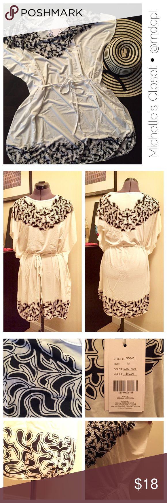 Cover-up Polyester spandex blend, waist tie. Semi sheer ecru fabric with dark navy design. 5th & Love Swim Coverups