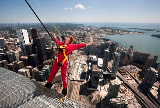 DANGLE OFF OF CANADA'S TALLEST TOWER Live on the edge courtesy of EdgeWalk in Toronto at the CN Tower, the tallest free-standing structure in the western hemisphere. Secured with heavy-duty locking carabineers connected to rings on the harnesses, EdgeWalk involves walking or leaning backward or forward on a five foot (1.5 meters) wide ledge of the CN Tower's restaurant, 1,168 feet (356 meters) above the ground.